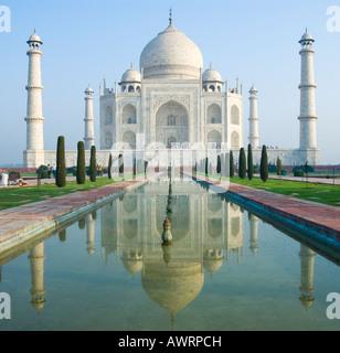 The Taj Mahal reflected in the fountain in Agra India - Stock Photo