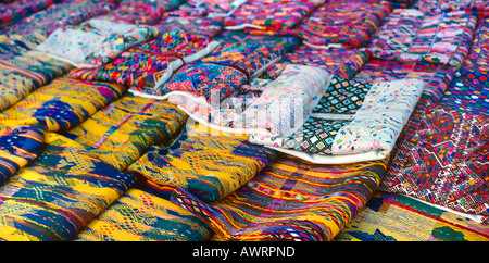 A selection of hand woven textiles being sold in the street in Antigua Guatemala TRIBAL TEXTILES - Stock Photo