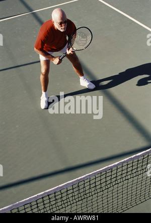 Mature man playing tennis - Stock Photo