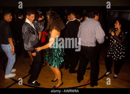 Guatemalan-American people, teenagers, teen boys, teen girls, teen dance, dancers, dancing, Quinceanera party, city - Stock Photo