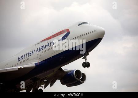 A British Airways Boeing Jumbo Jet takes off at London Heathrow Airport - Stock Photo