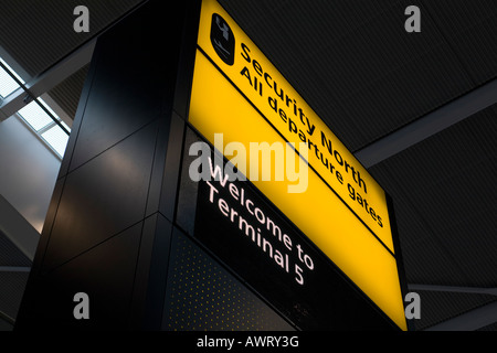 Security and welcome notice sign at London Heathrow Airport Terminal 5 - Stock Photo