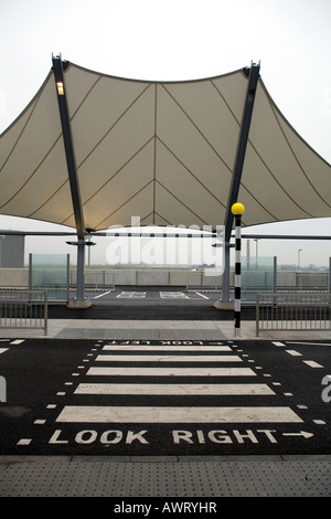 A pedestrian crossing point outside London Heathrow Airport Terminal 5 - Stock Photo