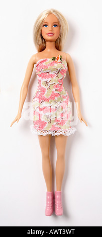 Barbie doll on white background wearing a pink dress - Stock Photo