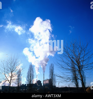PULP PAPER PLANT SMOKESTACKS AND LEAFLESS TREES STRASBOURG ALSACE FRANCE - Stock Photo