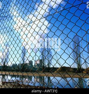 WIRE FENCE AND PULP PAPER PLANT SMOKESTACKS STRASBOURG ALSACE FRANCE - Stock Photo