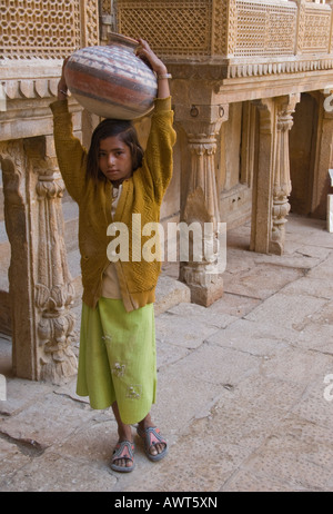 Portrait of a young girl carrying a water jug in Jaisalmer, Rajasthan, India. - Stock Photo