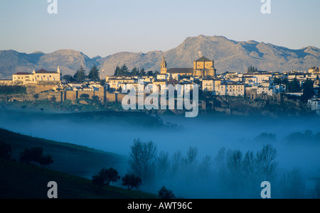 Ronda in the province of Malaga Andalucia Spain. Valley with early morning mist Moody Landscape photography mountains - Stock Photo