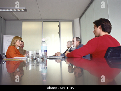 Business people sitting at table in meeting  room. - Stock Photo