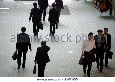 businessmen on their way to meetings - Stock Photo