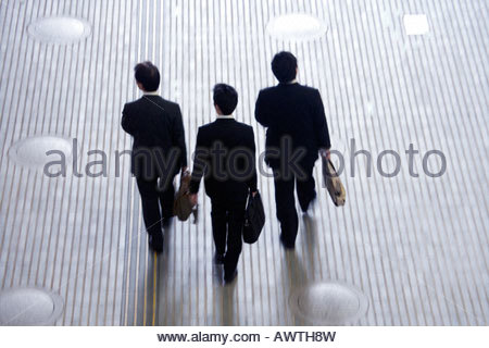 3 businessman on their way to a meeting - Stock Photo