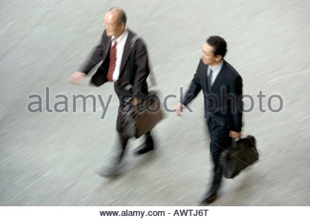 overhead view of two businessmen walking - Stock Photo