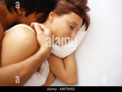 Man and woman in bed - Stock Photo
