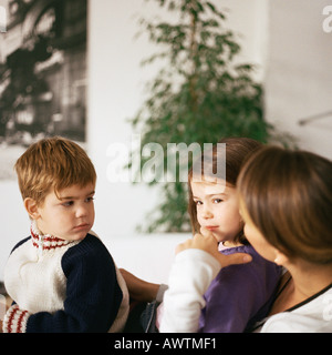 Children sitting with mother - Stock Photo