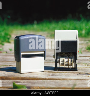Date stampers on wooden walkway - Stock Photo