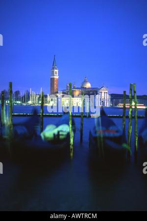 San Giorgio Maggiore at twilight night Blurred gondolas in foreground  Venice Veneto Italy - Stock Photo