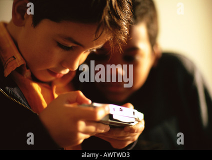 Young boys playing game - Stock Photo