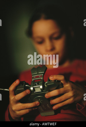 Child playing video game, blurred, close up - Stock Photo