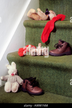 Shoes toys Teddy Bear socks abandoned on a back staircase - Stock Photo