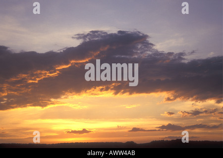 A beautiful sunset sky over the African plains in the Serengeti National Park Tanzania East Africa - Stock Photo