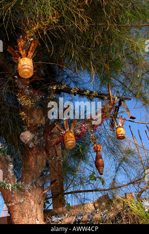 Laos Phonsavan Christmas Tree decorated with Unexploded Ordnance UXO and tinsel - Stock Photo