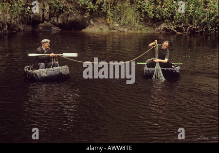 Fishing with nets from traditional simple coracles on The River Teifi near Cardigan Dyfed - Stock Photo
