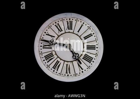An old enamelled iron wall clock face (France). Cadran d'horloge ancienne en tôle émaillée (France). - Stock Photo