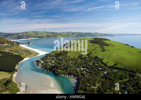 Purakanui Inlet Township and Bay north of Dunedin South Island New Zealand aerial - Stock Photo