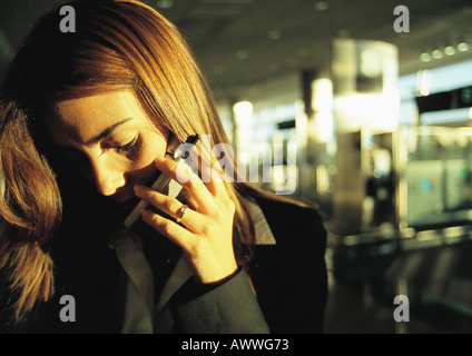 Businesswoman talking on cell phone, close up. - Stock Photo
