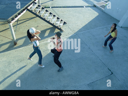 Young people playing with ball, high angle view