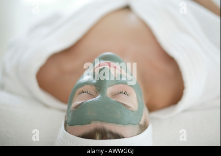 A woman relaxing in a face mask - Stock Photo