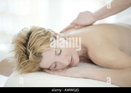 A woman in her forties having a massage - Stock Photo