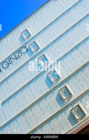 Closeup of building with modern architecture in upscale Ginza district of Tokyo Japan - Stock Photo
