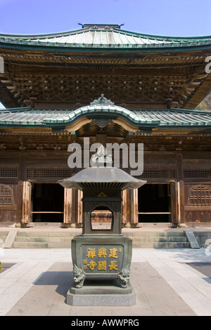 Incense burner in front of Butsuden the Buddha Hall in Kenchoji a Zen Buddhist temple in Kamakura Japan - Stock Photo