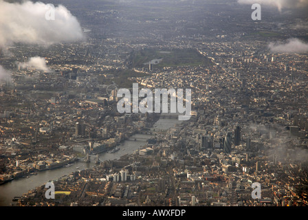 Aerial view of central London looking west across the River Thames. The City and Tower Bridge. England - Stock Photo