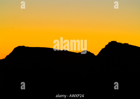 Silhouette of Mount Dumbier, Nizke Tatry mountain range, Slovakia, before sunrise - Stock Photo