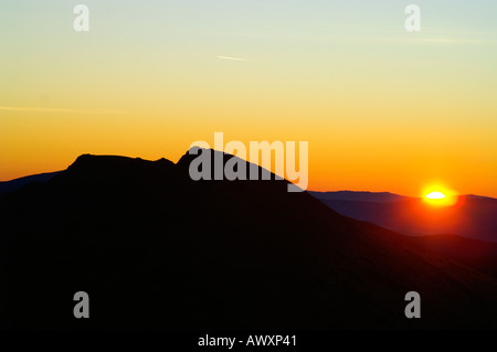 Silhouette of Mount Dumbier, Nizke Tatry mountain range, Slovakia, sunrise - Stock Photo