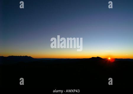 Silhouette of Mount Dumbier and Vysoke Tatry mountain range, Slovakia, sunrise - Stock Photo