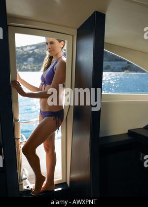 Woman Wearing Bikini on Yacht - Stock Photo