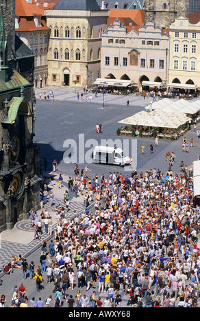 CZECH REPUBLIC PRAGUE OLD TOWN SQUARE TOURISTS IN FRONT OF THE ASTRONOMICAL CLOCK - Stock Photo