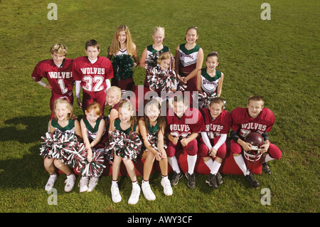 Young football players and cheerleaders - Stock Photo