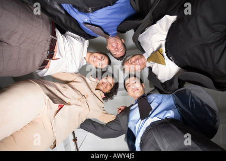 Group Portrait of Business People in Huddle - Stock Photo