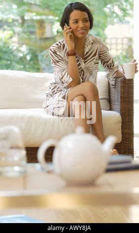 Woman Using Cellular Phone - Stock Photo