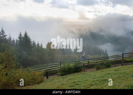 Misty early daybreak in autumn Carpathian mountain (Ukraine) - Stock Photo