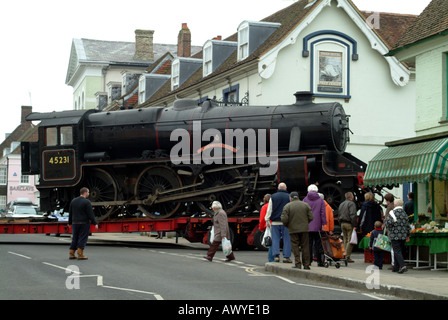 The Sherwood Forester steam engine being transported by low loader heavy haulage truck to Mid Hants Railway in Alresford - Stock Photo