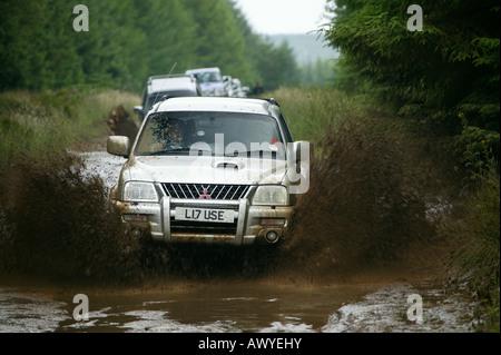 Mitsubishi L200 in watersplash - Stock Photo