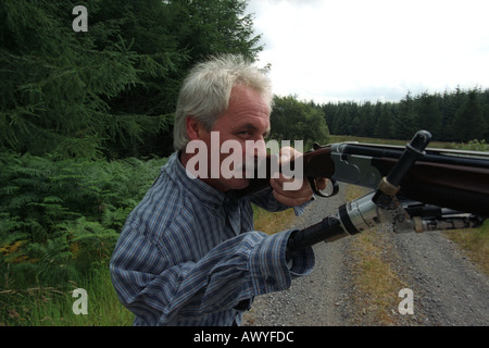 Campbell Aird who is fitte with a robotic arm clay pigeon shooting in Scotland - Stock Photo