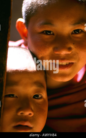 Portrait of two monks inside the Ringpun Dzong in Paro, Bhutan. - Stock Photo