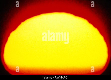 enlarged sun background red yellow black - Stock Photo