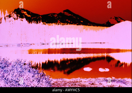 abstract black mountains reflected in lake negative false color - Stock Photo